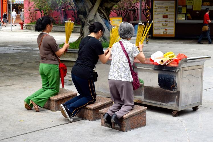 Praying outside Po Lin Monastery