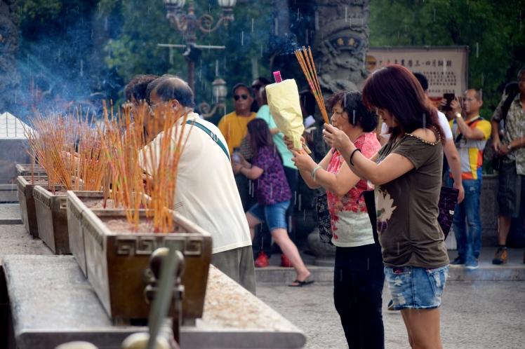 Praying at Won Tai Sin