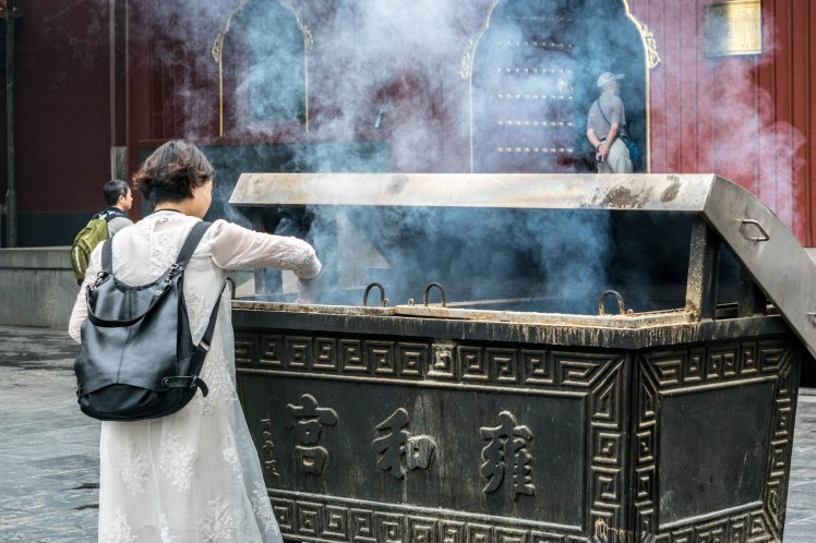 lady offering incense